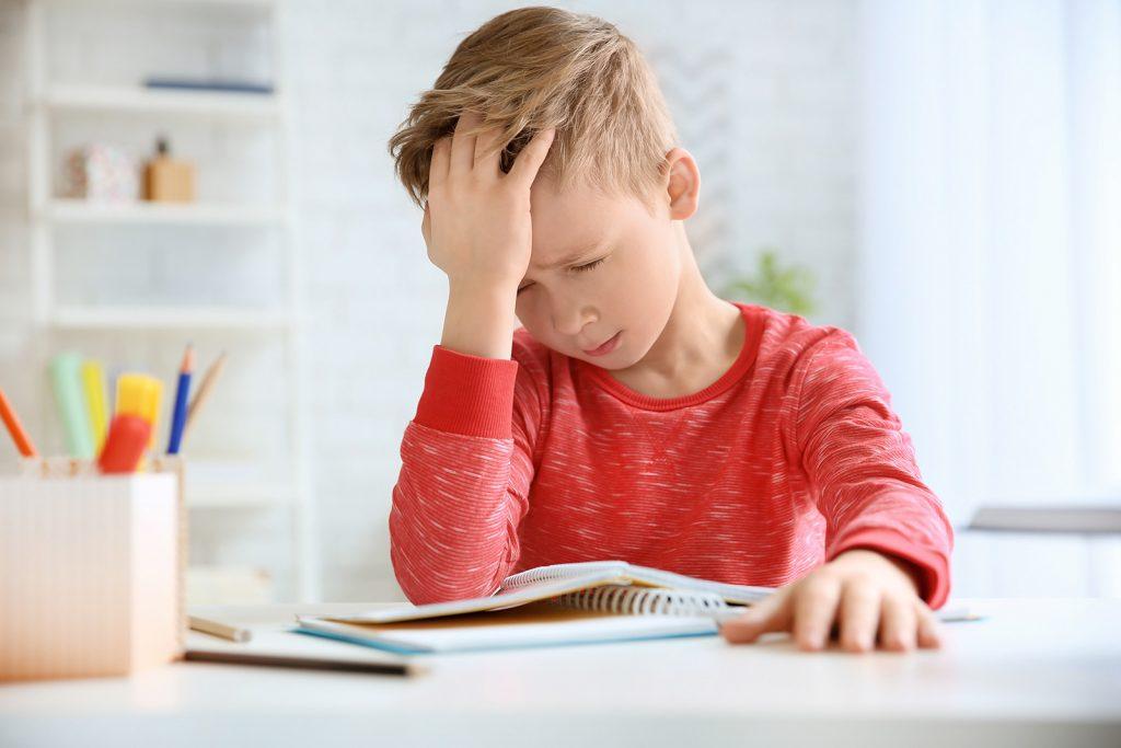 Chlapec a bolesť hlavy