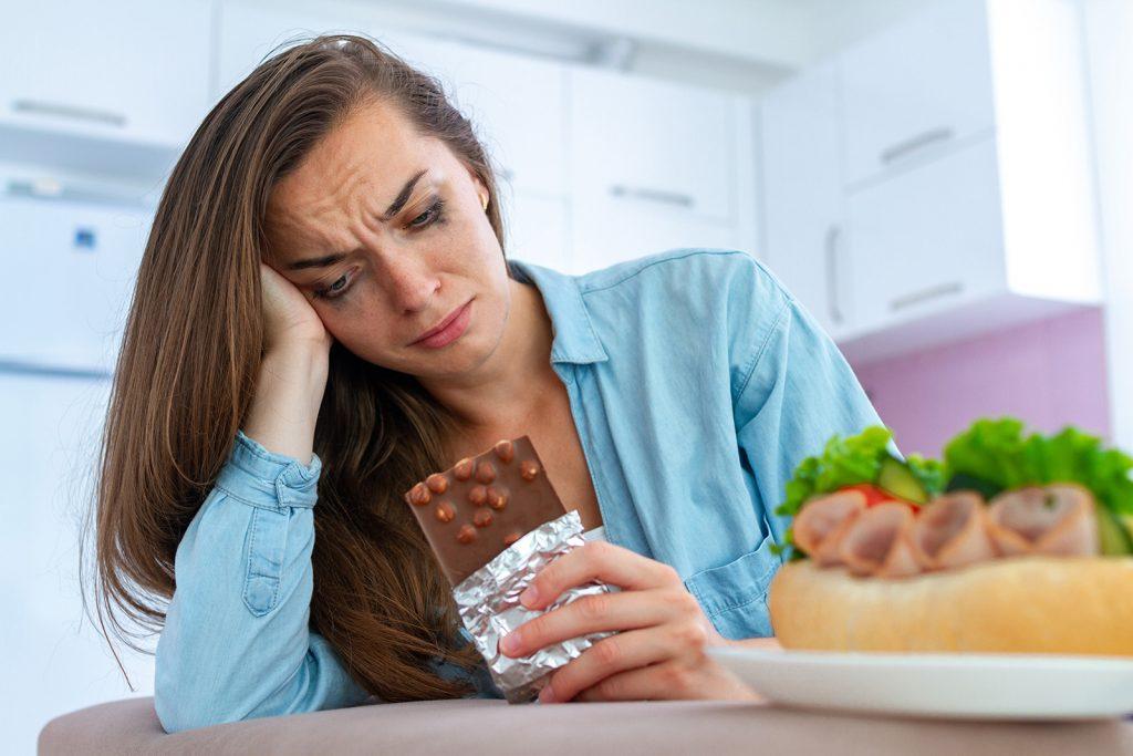 Nešťastná žena je čokoládu